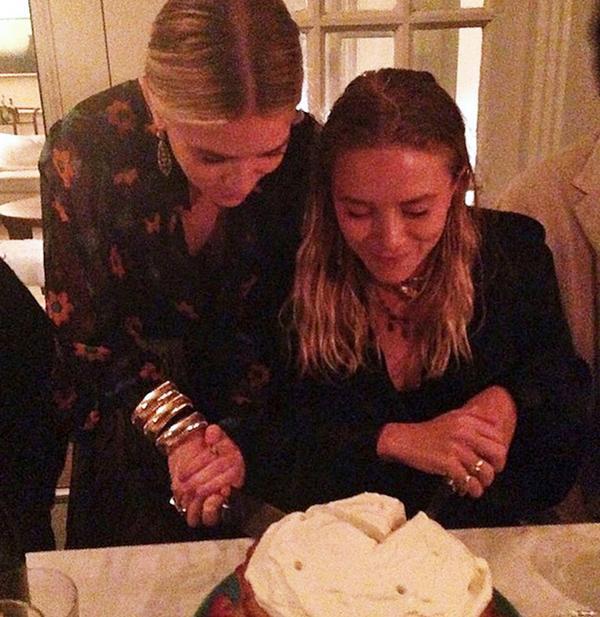 Mary-Kate and Ashley Olsen celebrating their 28th birthday.