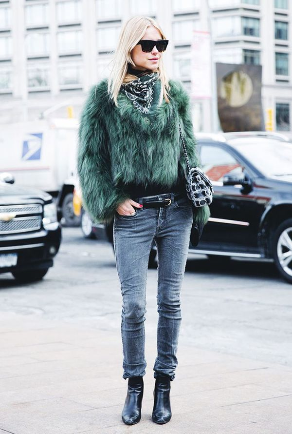 Make a bold statement by pairing your skinnies with a colorful furry coat and black boots.