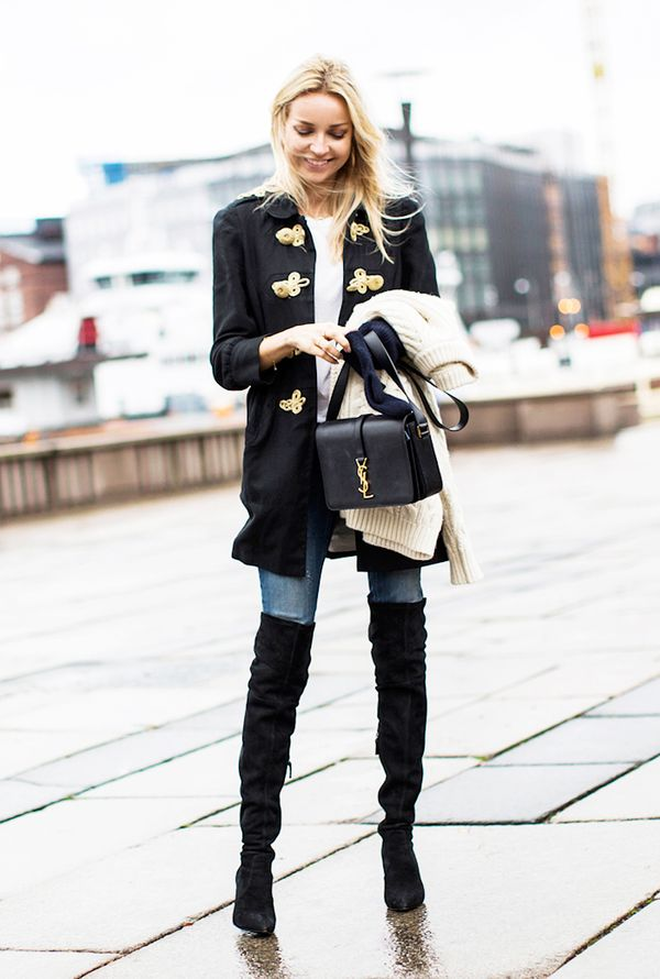 An embellished jacket adds intrigue to a simple top, skinny jeans, and over-the-knee boots.