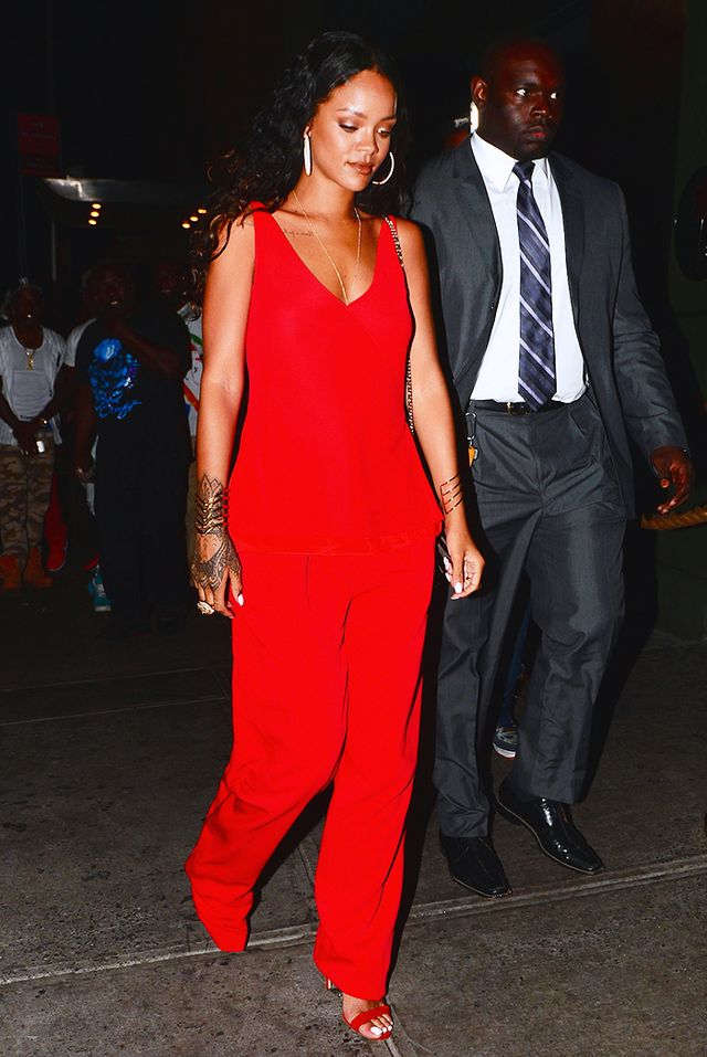 To attend a fashion week party in New York, the singer opted for an all-red ensemble down to her shoes, wearing an Edun Red Bias Cut Spaghetti Strap Tank Top and Red Double Pleat Trouser from...