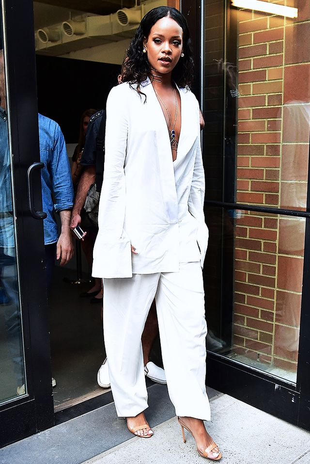 While making the rounds at New York Fashion Week this past September, Rihanna turned heads in an Edun S/S 15 suit, Jacquie Aiche Outward Teardtop Trinity Bodychain With Partial Pave Diamonds...