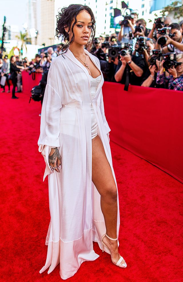 Never one to miss a red carpet fashion moment, the singer attended the 2014 MTV Movie Awards in an Ulyana Sergeenko S/S 14 Robe Dress and Bodysuit, Ana Khouri Pearl & Gold Jane Ear Cuff...