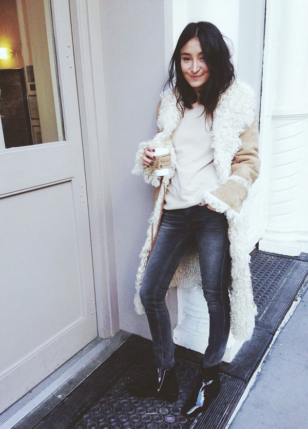 Her coffee cup perfectly matches her rad shearling coat. An accident? We think not.