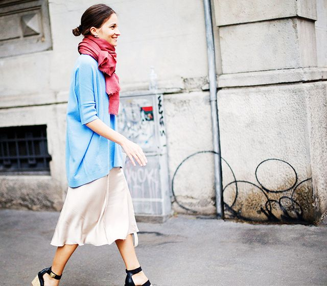 Try tying your scarf around your neck like this, and using it to top off a casual daytime look of a chambray top and full skirt.