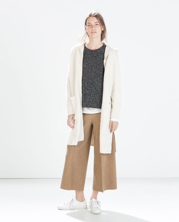 Shop The Look: Zara Sweater With Round Hem ($60) + Long Soft Cardigan ($100) + Studio Knit Trousers ($129) + Leather Sneakers ($80)