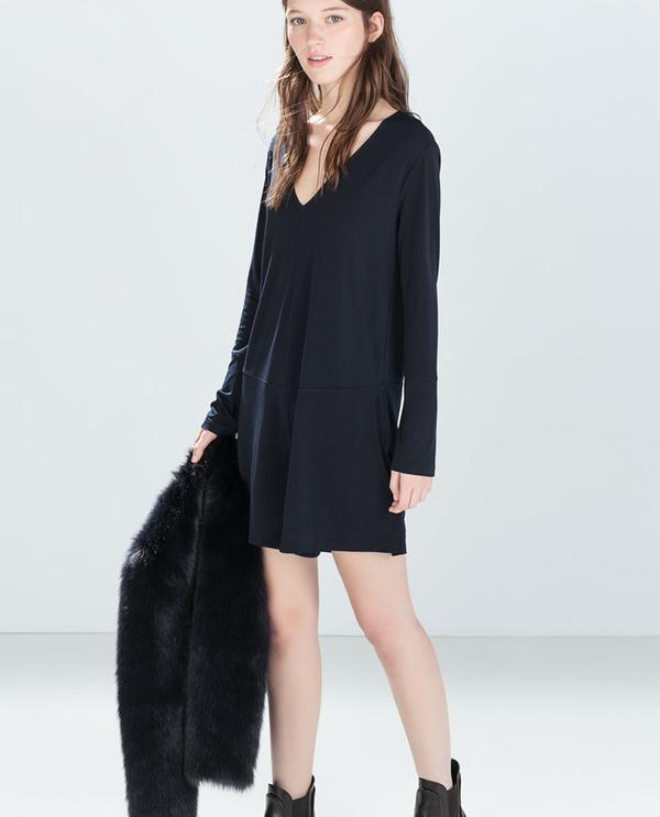 Shop The Look: Zara Flared Jumpsuit ($50) + Fur Jacket ($100)