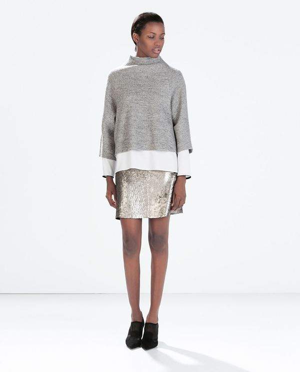 Shop The Look: Zara Studio Funnel Collar Top ($100) in Grey + Top With Contrast Piping ($70) +Sequined Miniskirt ($60) in Silver +High-Heeled Mesh Booties ($80) in Black