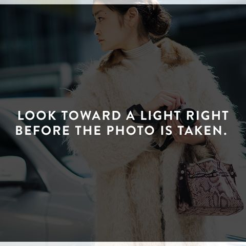 How to Look Photogenic: Look toward a light right before the photo is taken