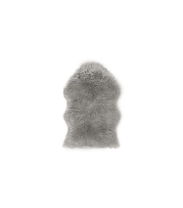 Urban Outfitters Faux Fur Shaped Sheepskin Rug