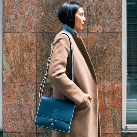 Camel coat with turtleneck and structured bag