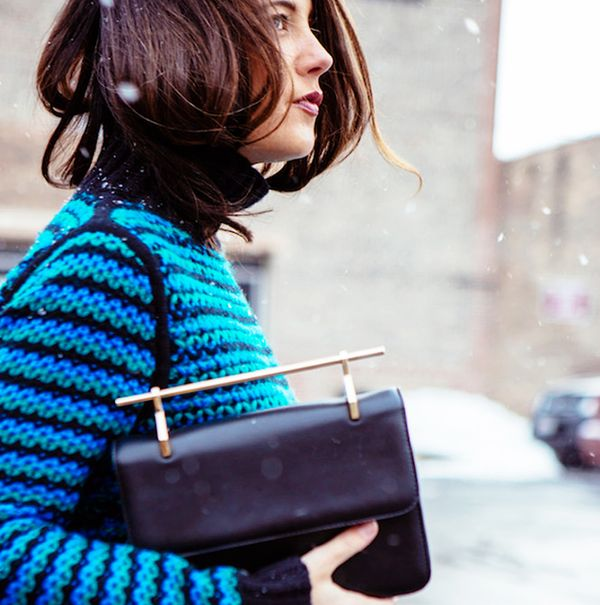 Colorful knit turtleneck with gold hardware purse