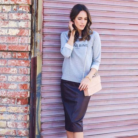 Sweatshirt with leather midi skirt and structured shoulder bag