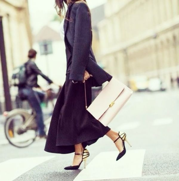 Striped oversized blazer, black skirt, and gold-accent heels
