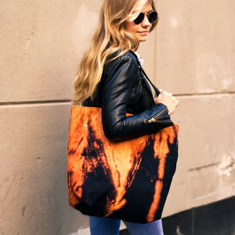 Leather jacket and oversized print tote bag