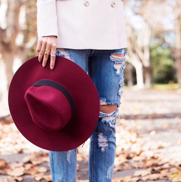 Tailored white coat with distressed denim and red felt hat