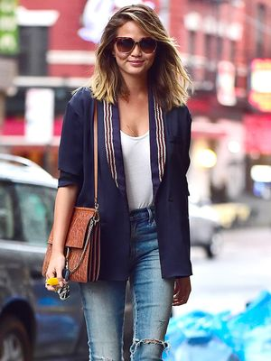 Chrissy Teigen Looks Effortlessly Polished in Distressed Denim