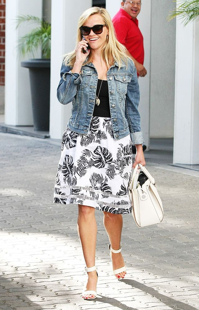 On Reese Witherspoon: Fidelity Denim Ryder Jacket ($198) in Exile Destruct; J.O.A. Tropical Safari Skirt ($108); The Row Satchel 12 Textured-Leather Tote ($2850); Stella...