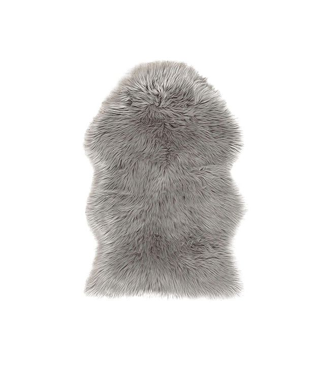 Urban Outfitters Faux Sheepskin Shaped Rug