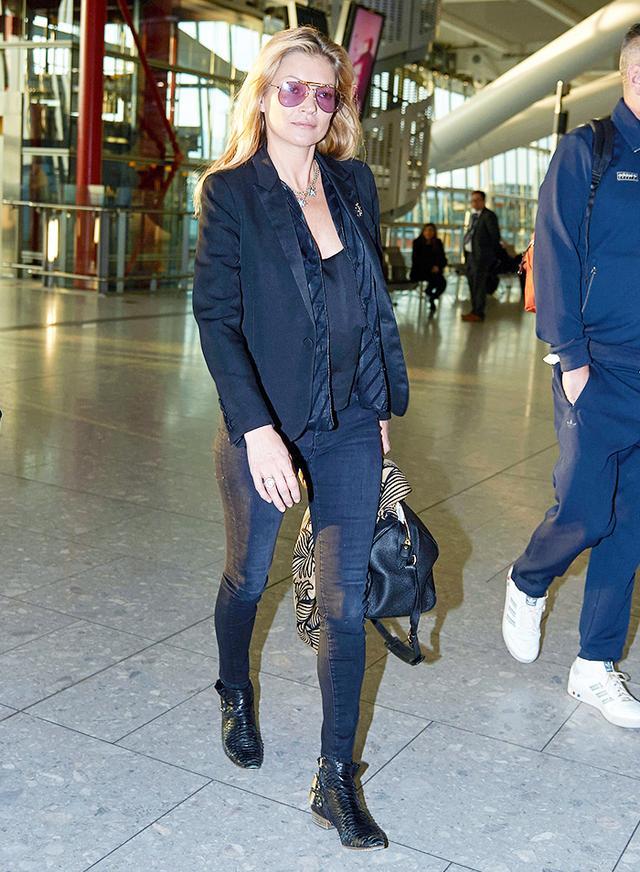 On Moss: Louis Vuitton bag.