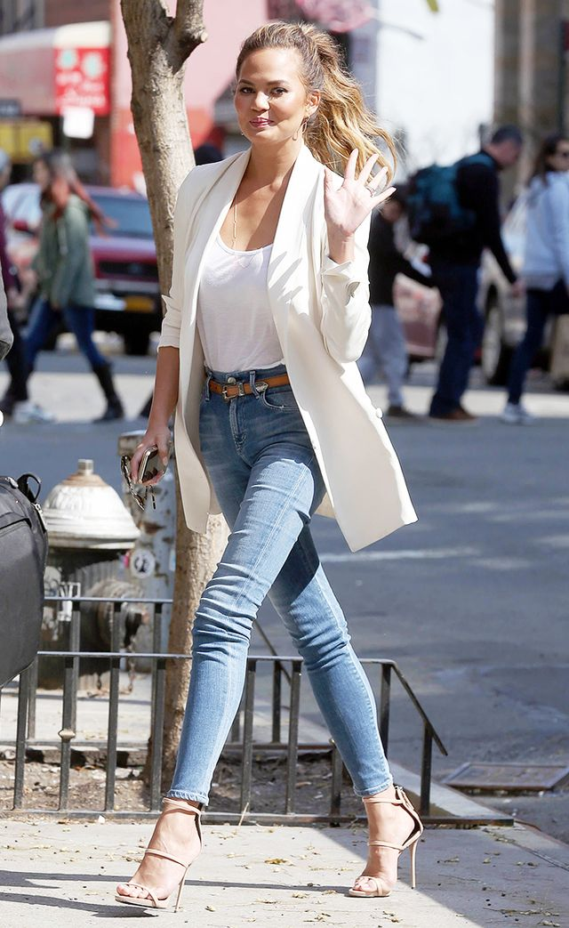 On Chrissy Teigen: Citizens of Humanity jeans; Giuseppe Zanotti Coline Point Toe Sandals ($845); Saint Laurent belt.