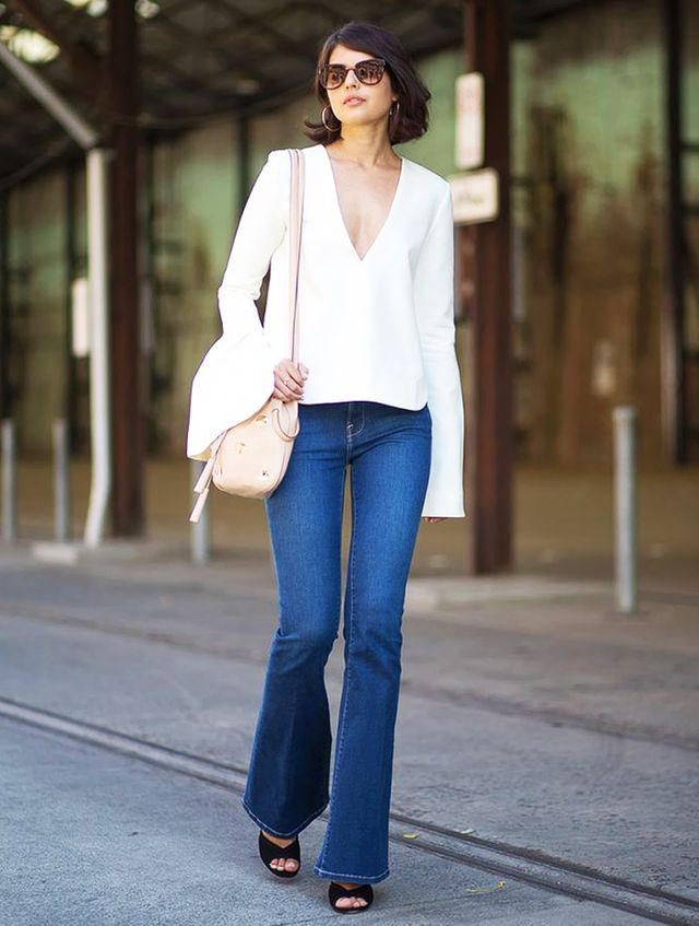 As you well know by now, the '70s are back in a big way this season, and no one has tackled the era's flared jeans quite like the Aussies. They keep the look modern by pairing them...