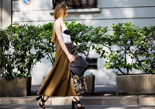 A sleek maxi dress paired with structured accessories is the most city-friendly look: