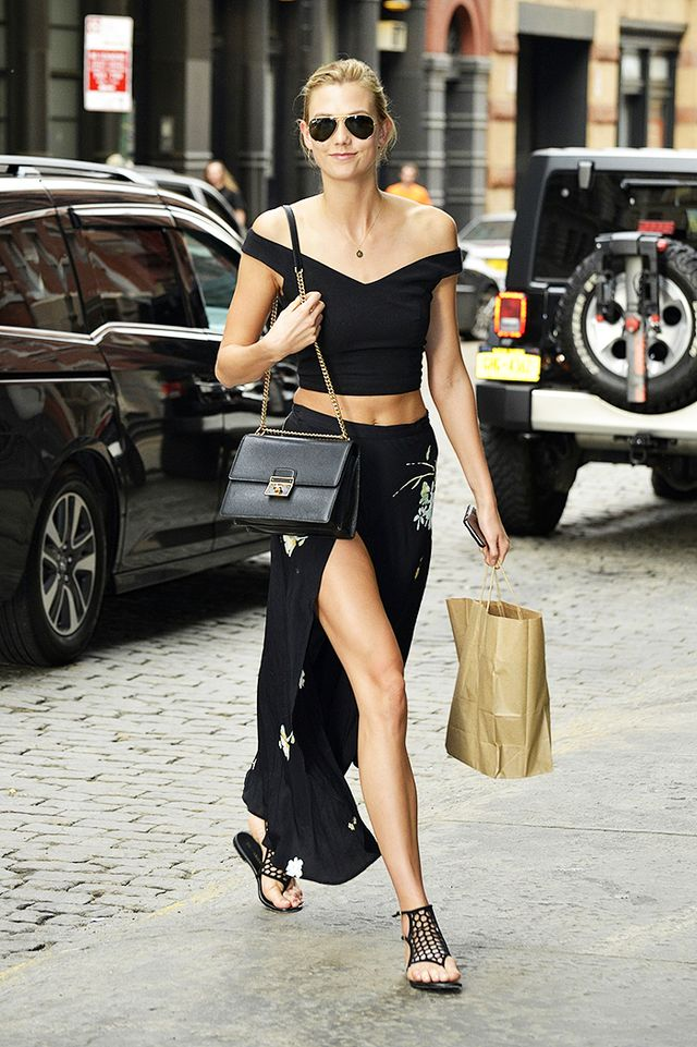 On Kloss: Ray-Ban Aviator Sunglasses ($150); Dolce & Gabbana purse; Tamara Mellon sandals.