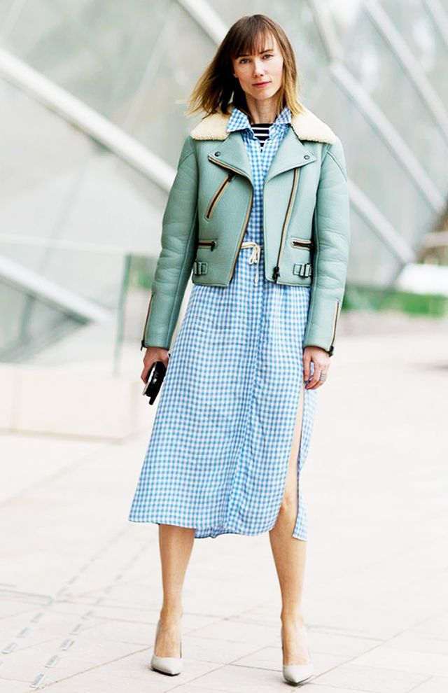 Layer a colorful jacket over a printed midi dress, and accessorize with neutral pumps.