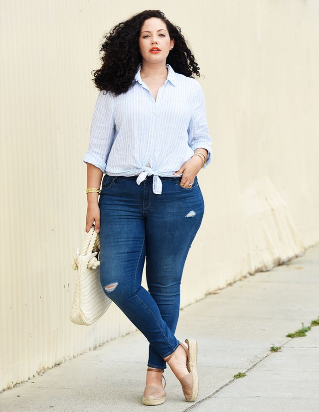 Partner a set of high-waisted jeans with a verticallystriped button-downblousetied at the waist. It's a perfect combo and flattering on every body type.