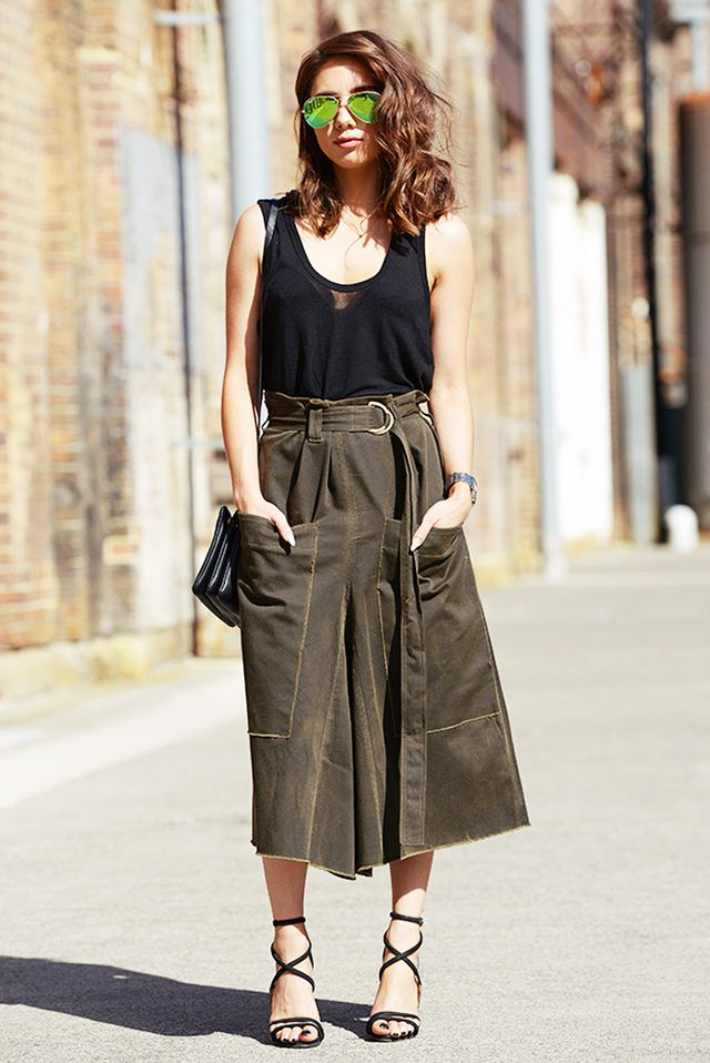 A more voluminous skirt is best worn at the waistand paired with a classic, well-fitted cotton tank top.