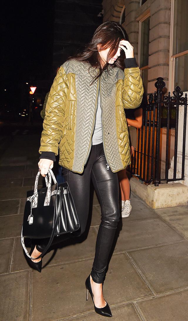 On Jenner: Helmut Lang Faux-Pocket Leather Leggings ($920); Saint Laurent Sac de Jour Small Tote Bag ($2750); Gianvito Rossi Ellipsis Pumps ($765); H&M jacket.