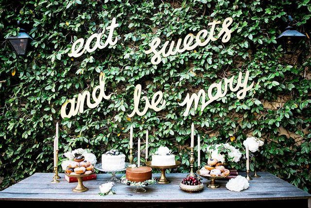 "A set of custom signs behind the dessert table brought a tear to the mom-to-be's eyes. ""We love creating memorable moments like that at our events,"" says LaRocca. ""Having..."