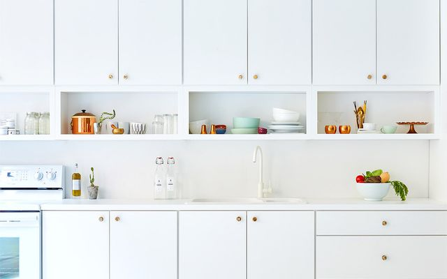 A white faucet from IKEA keeps the whiteout look of this office kitchen consistent.