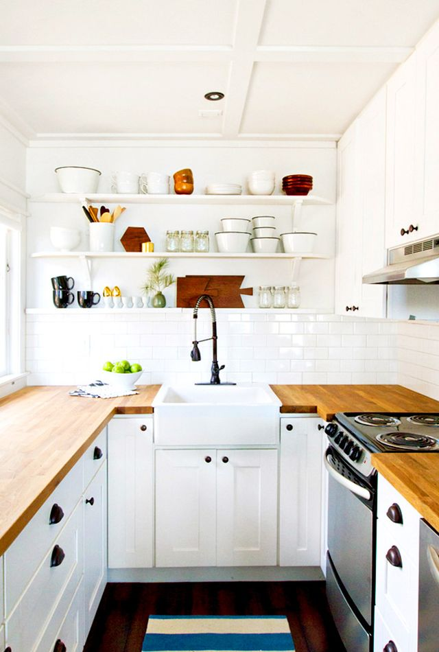 Open shelves and expert styling make this kitchen a stunner, but we can't take our eyes off the industrial faucet, rich wood counters, and generous farmhouse sink, all of which were...