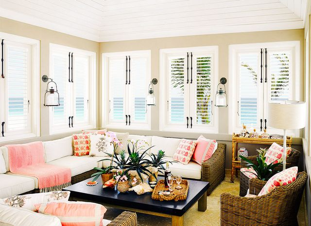 Woven Furniture And A Mix Of Patterns In A Pleasing Coral Hue Add Texture  And Interest