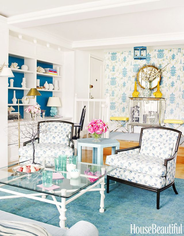 A mix of sweet prints and bold colors enlivens this small Manhattan home's living room. Layered blue tones givethe space a real sense of depth while white ceramics and coral specimens...