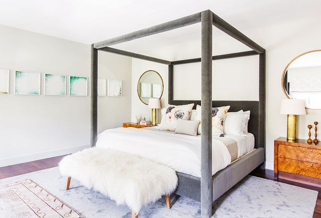 """In the master bedroom, a luxurious velvet bed steals the scene. """"A large master bedroom is great opportunity for a four-poster bed, as it creates a cozy and inviting refuge,"""" Sklar..."""