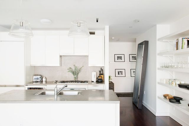 Head toElle Decorto see the rest of this home.  Could you live in an all-white space? Share why or why not in the comments!