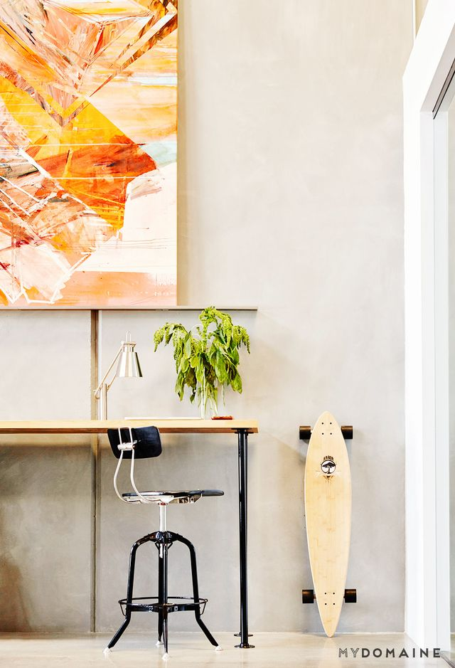 """A mix of glass-walled offices, standing desks, and long tables enables employees to work however they are most comfortable. """"We wanted to take everyone's work style into..."""