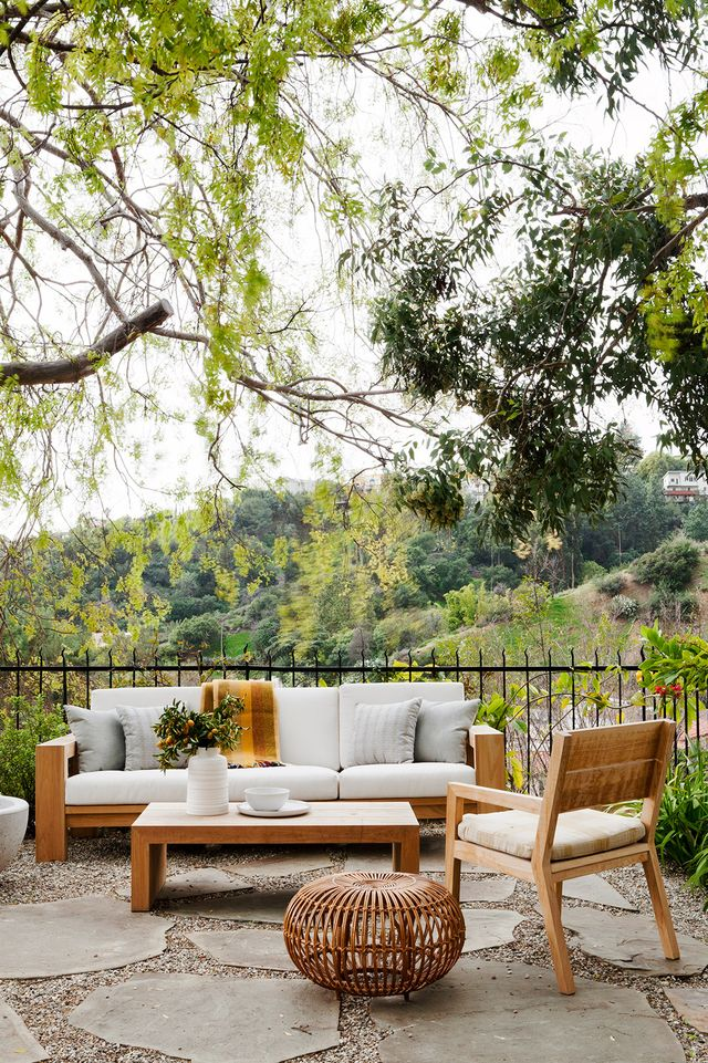 A creamy palette with woven accents complement the rustic surroundings of this Beachwood Canyon family home.