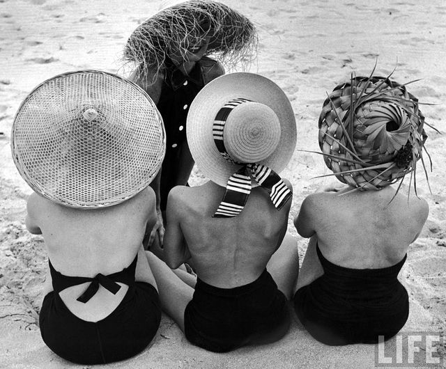 Our takeaway from this classic Nina Leen snap? A black one-piece bathing suit and straw hat arealways a good idea.