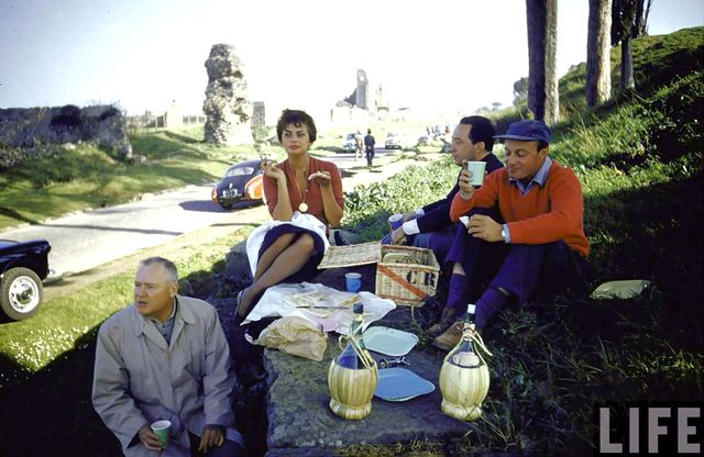 Sophia Loren picnics in style along the Appian Way, an ancient Roman road.