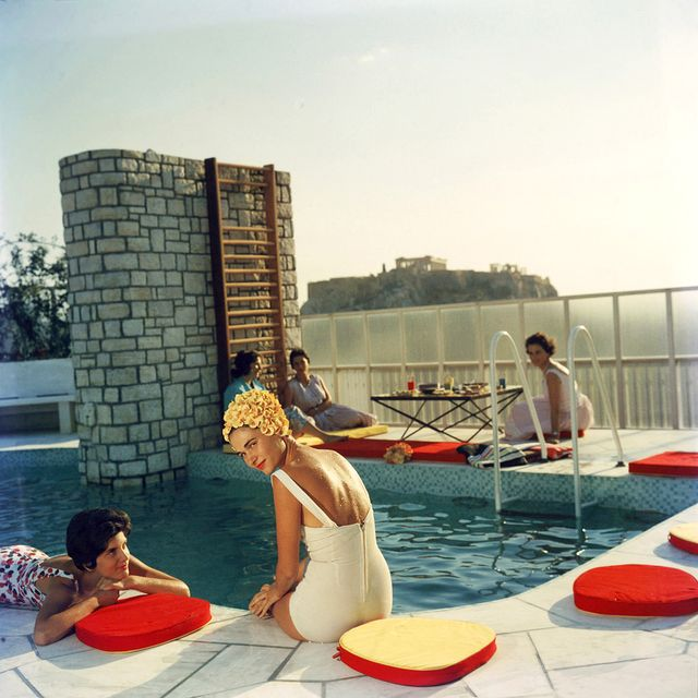 Slim Aarons is known for having captured some of the most glamorous vacationers. This swimming cap–sporting beauty stuns.