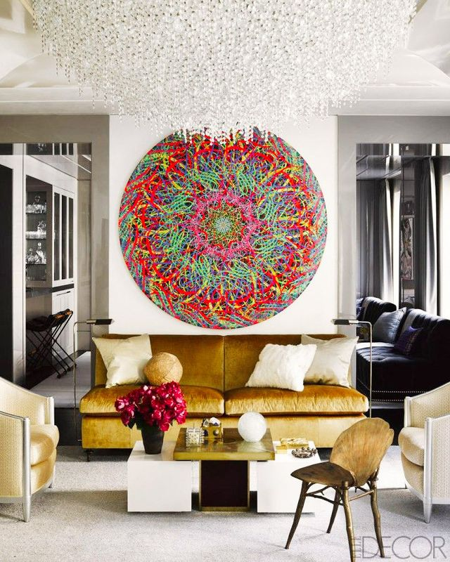 A spectacularly sized flush mount chandelier gorgeously crowns this high-style space.