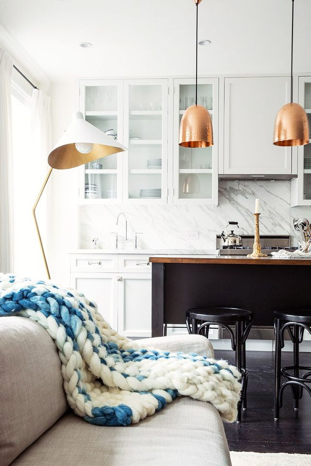 Rosy metallic hues complement this downright dreamy living and kitchen space.