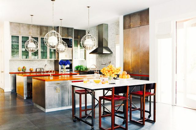 Nate Berkus knows the power of lighting in unexpected places. Here, a quartet of chrome globe pendants makes a bold statement in a kitchen.