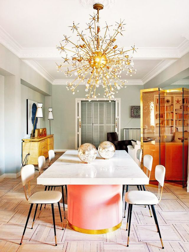 A whimsical burst of gold perfectly crowns this playfully feminine dining space.