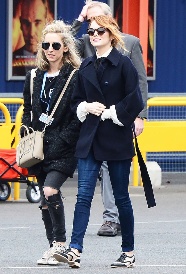 Emma Stone: Pea coat + Tie-neck blouse + Skinny jeans + Oxfords