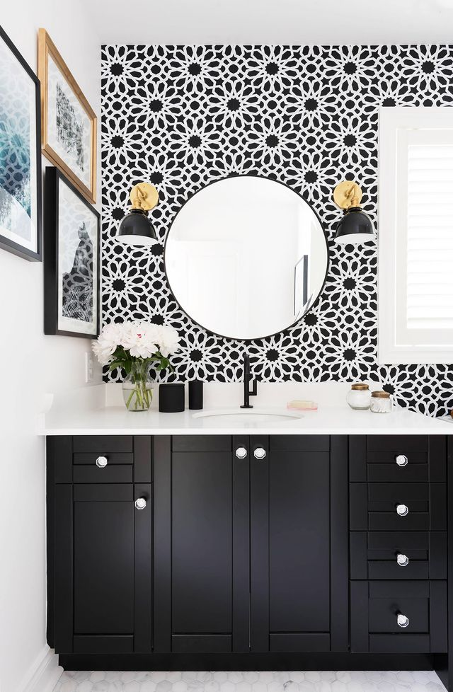 """""""My daughter and I were both drawn to bathrooms with a black-and-white color scheme, so I knew I had to paint her vanity black and add white in the form of the marble hexagon floor tiles and..."""