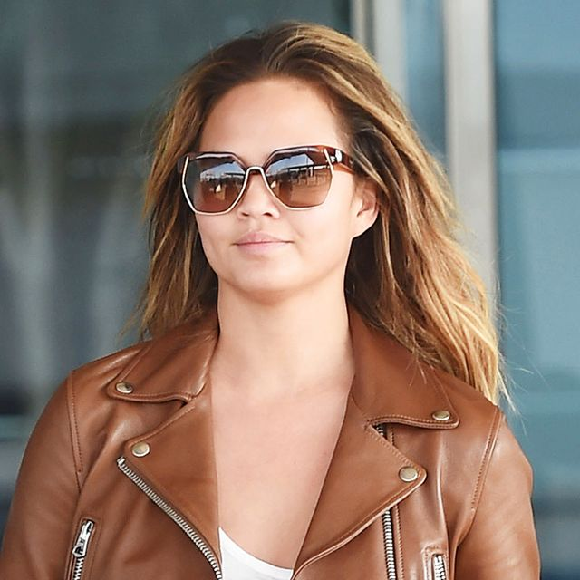 Chrissy Teigen Wears the Perfect Leather Jacket at the Airport